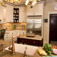 Light wood cabinets with granite kitchen counter tops