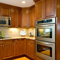 Medium brown kitchen cabinets with granite counter tops