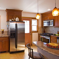 Medium Brown Kitchen Cabinets and Granite Counter Tops
